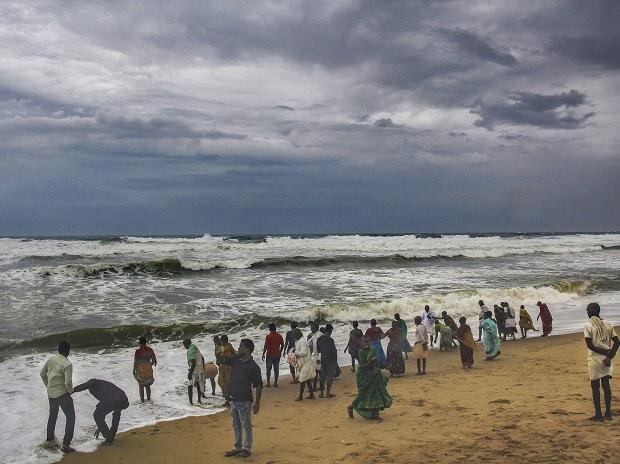 Villagers at the beach as dark clouds hover above the sea ahead of cyclone Fani, in Puri on Thursday | Photo: PTI