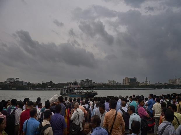 Cyclone Fani: Office goers wait for a ferry to travel across a river during rainfall, in Kolkata, Friday, May 3, 2019. (PTI Photo)