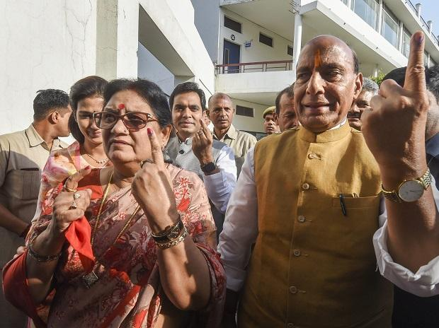 Union Minister and BJP candidate from Lucknow, Rajnath Singh, and his wife Savitri Singh show their finger marked with indelible ink after casting vote at a polling station during the fifth phase of the 2019 Lok Sabha elections, in Lucknow, Monday