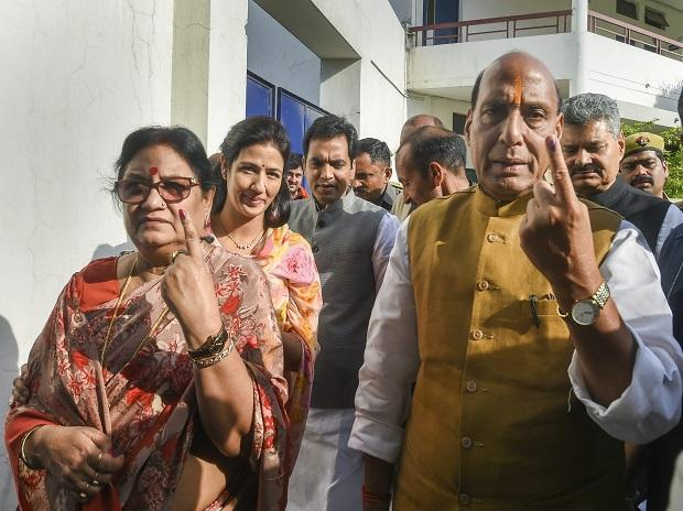 Union Minister and BJP candidate from Lucknow, Rajnath Singh, and his wife Savitri Singh show their finger marked with indelible ink