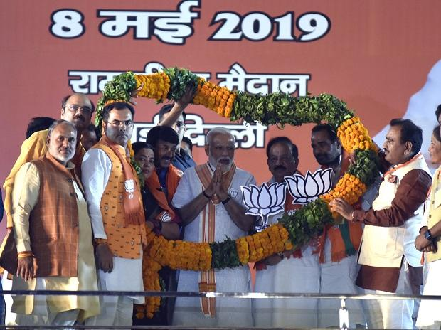 Prime Minister Narendra Modi with Delhi Lok Sabha Election Candidates at Ram Lila Ground during BJP Rally in New Delhi on Wednesday/PHOTO-DALIP KUMAR