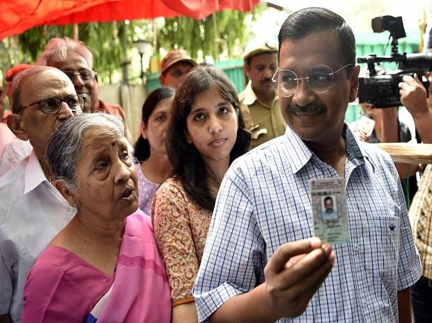 Delhi Chief Minister Arvind Kejrival with Family members arriving to cast their vote during the sixth phase of Lok Sabha elections, in New Delhi, Sunday/PHOTO-DALIP KUMAR