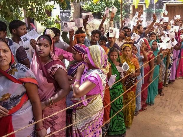 People wait in a queue to cast their vote during the sixth phase of Lok Sabha elections, in Sultanpur   Photo: PTI