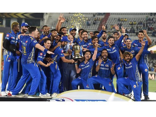Mumbai Indians (MI) skipper Rohit Sharma with his teammates celebrating with Indian Premier League 2019 winning trophy after win over Chennai Super Kings (CSK) at the Final cricket match at Rajiv Gandhi International Cricket Stadium in Hyderabad. Pho