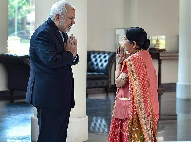 External Affairs Minister Sushma Swaraj greets Iranian Foreign Minister Mohammad Javad Zarif  in New Delhi on Tuesday 	Photo: PTI