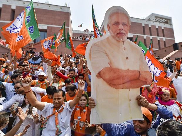 BJP supporters carry a cut-out of PM Narendra Modi as they celebrate the party's victory in the 2019 Lok Sabha elections, in New Delhi | Photo: PTI