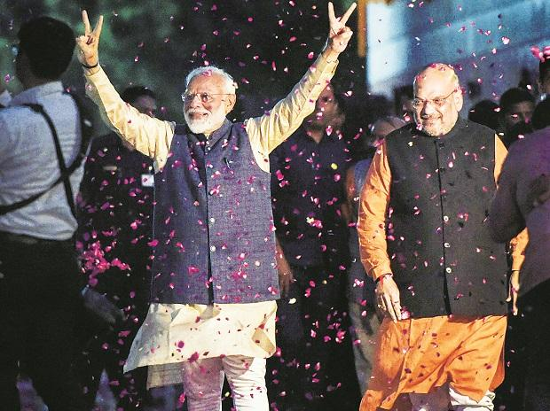 Prime Minister Narendra Modi (left) and BJP President Amit Shah receive a grand welcome at the party headquarters in New Delhi on Thursday | Photo: PTI