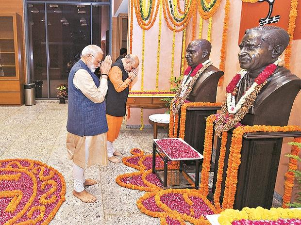 PM Narendra Modi and BJP President Amit Shah pay tribute to S P Mukherjee and Deen Dayal Upadhyay at the party headquarters, in New Delhi on Thursday  | Photo: PTI