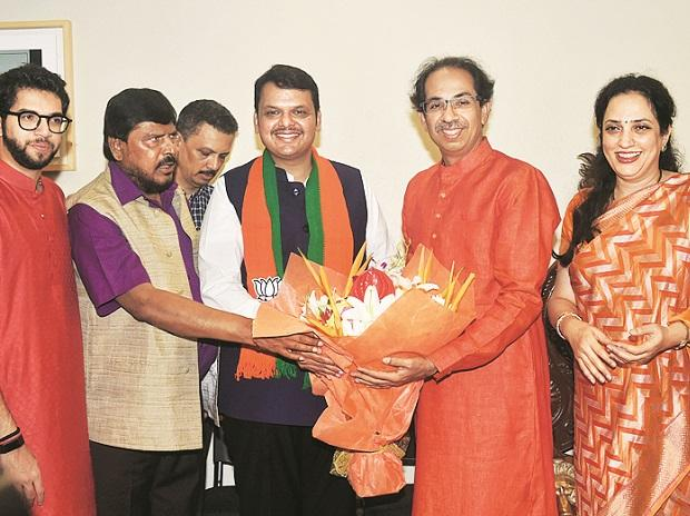 CM Devendra Fadnavis and Shiv Sena chief Uddhav Thackeray celebrate NDA's victory in Mumbai on Thursday | Photo: PTI