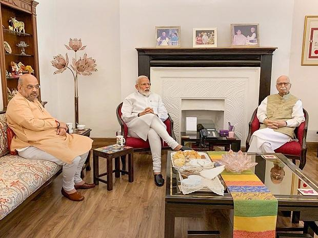Prime Minister Narendra Modi and BJP President Amit Shah meet party's senior leader LK Advani after their victory in the Lok Sabha elections