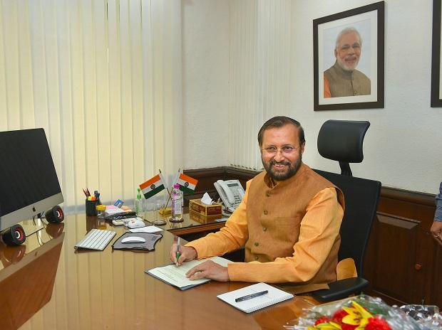 Prakash Javadekar takes charge as Minister of Environment, Forest and Climate Change; and Minister of Information and Broadcasting in the newly-elected PM Modi's cabinet, in New Delhi