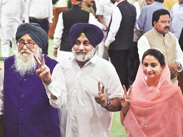 Parkash Singh Badal, patron of the SAD, with son Sukhbir and daughter-in-law Harsimrat. Only Sukhbir and Harsimrat managed to win seats for the SAD in the Lok Sabha polls. Photo: PTI