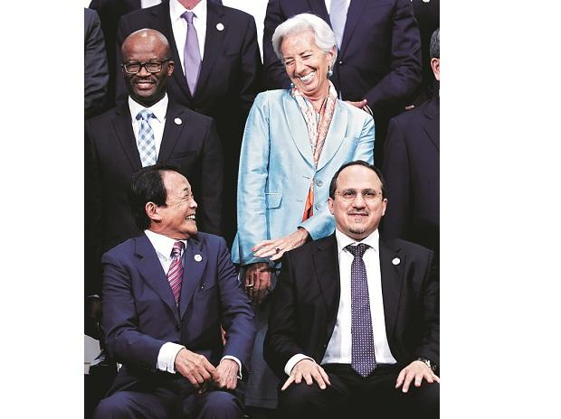 Japan's Finance Minister Taro Aso chats with IMF MD Christine Lagarde in Fukuoka