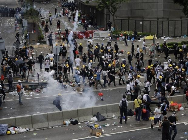 Riot police fire tear gas to protesters outside the Legislative Council in Hong Kong. | Photo: AP/PTI