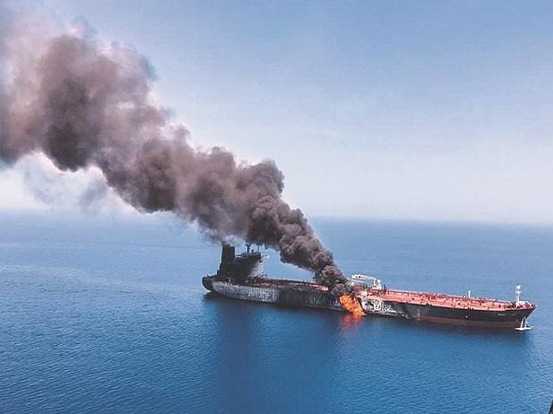 An oil tanker after being attacked near the Strait of Hormuz, on Thursday.  Crude oil prices had shot up briefly after the incident	Photo: Reuters