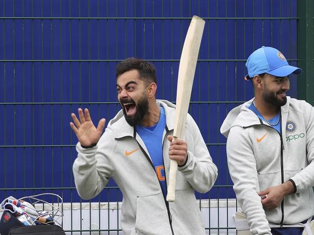 India's captain Virat Kohli, left, laughs as he reacts to a teammate during a training session ahead of their Cricket World Cup match against Pakistan at Old Trafford in Manchester. File Photo: AP|PTI