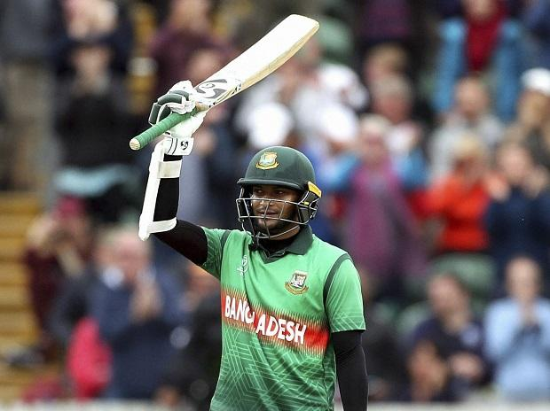Shakib-Al-Hasan raises his bat after hitting century against West Indies