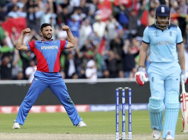File photo: Afghanistan's captain Gulbadin Naib, left, celebrates the dismissal of England's Jonny Bairstow