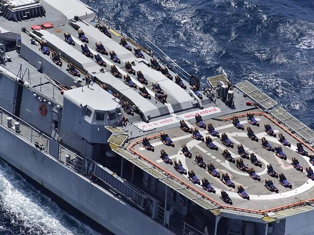 Indian Navy personnel perform Yoga on the deck of Indian Navy Ship (INS) Ranvir ahead of the International Day of Yoga 2019, in the Bay of Bengal