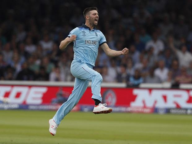 England's Mark Wood celebrates after taking the wicket of Australia's Glenn Maxwell caught behind