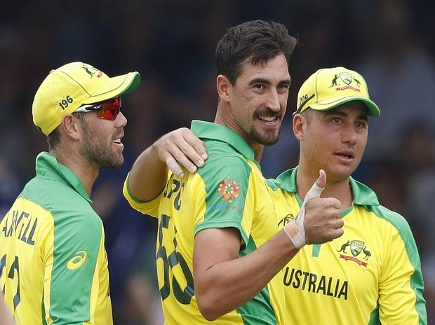 Australia's Mitchell Starc turns and give a thumbs up towards the dressing room after taking the wicket of England's captain Eoin Morgan