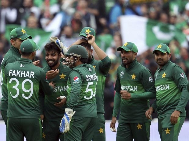 Pakistan's bowler Shadab Khan, third from left, celebrates with teammates after dismissing New Zealand's captain Kane Williamson for 41 run