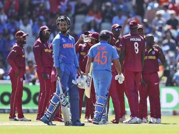 India's Rohit Sharma leaves the field after being dismissed