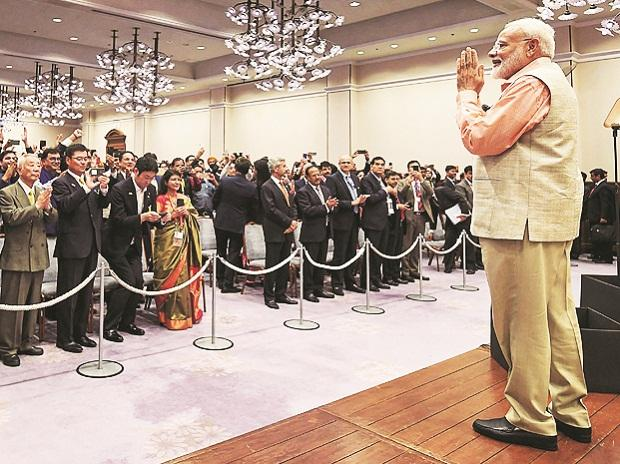 Prime Minister Narendra Modi greets the Indian community at a function in Kobe, Japan, on Thursday 	Photo: PTI