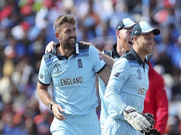 Birmingham:  England's Liam Plunkett, left, celebrates with teammates the dismissal of India's captain Virat Kohli during the Cricket World Cup match between England and India at Edgbaston in Birmingham, England, Sunday, June 30, 2019. AP /PTI Photo