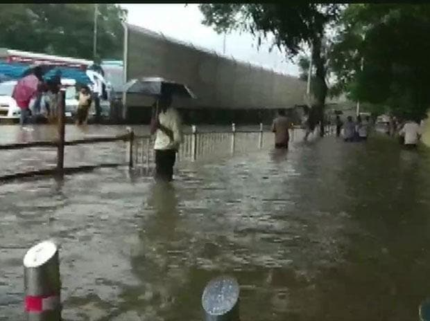 The heaviest downpour since 2005 inundated Mumbai, delaying trains and flights