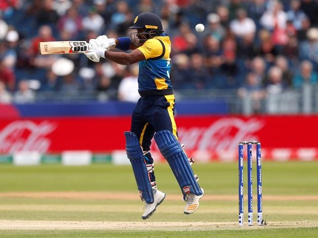 Sri Lanka skipper Dimuth Karunaratne plays a shot during a match against West Indies