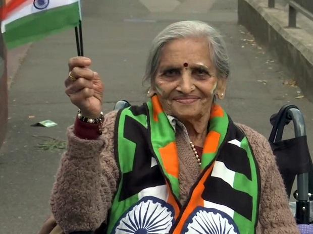 87-year-old Charulata Patel holds Indian flag and cheers for team India before a match between India and Bangladesh in ICC CWC 2019 at Edgbaston in Birmingham on Tuesday | Photo: ANI