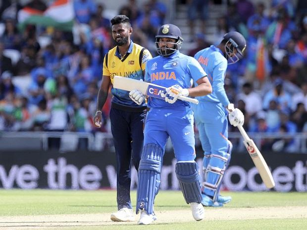 Sri Lanka's Isuru Udana, left, reacts after a boundary hit by India's Rohit Sharma, center, during the Cricket World Cup match between India and Sri Lanka at Headingley in Leeds, England on Saturday | Photo: PTI