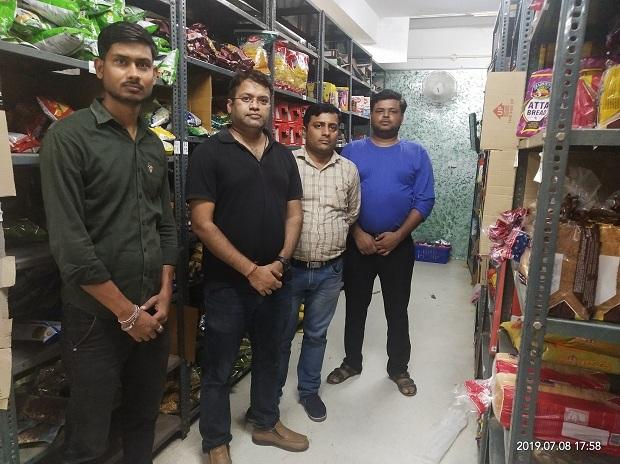 Founder and CEO of Satvacart, Rahul Hari (in black T-shirt) with his team at his warehouse