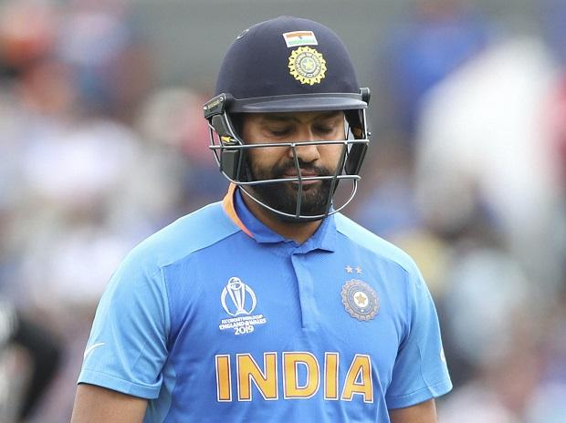 India's Rohit Sharma reacts as he leaves the field after being dismissed by New Zealand's Matt Henry