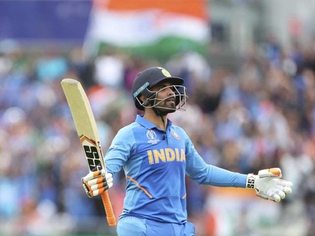 Manchester: India's Ravindra Jadeja reacts towards team's dressing room to celebrate scoring fifty runs during the Cricket World Cup semi-final match between India and New Zealand at Old Trafford. Photo: AP | PTI