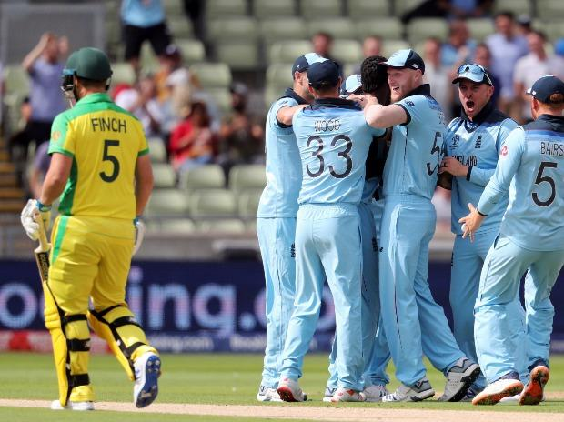 England players celebrate the wicket of Australia's captain Aaron Finch