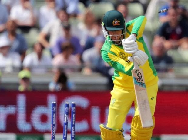 Australia's batsman Peter Handscomb is bowled out by England's bowler Chris Woakes for 4 runs