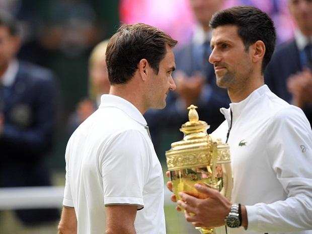 Djokovic(with the cup) and Federer after the final