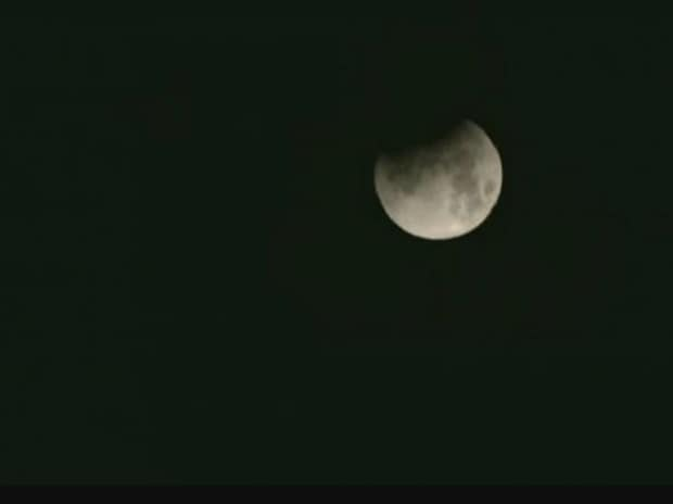 The partial lunar eclipse was seen like this in the cloudy skies of Delhi at 1.31 am.