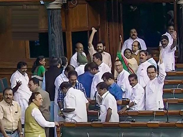 Opposition Congress members walk out of the Lok Sabha during the Budget Session of Parliament, in New Delhi, Wednesday | Photo: PTI