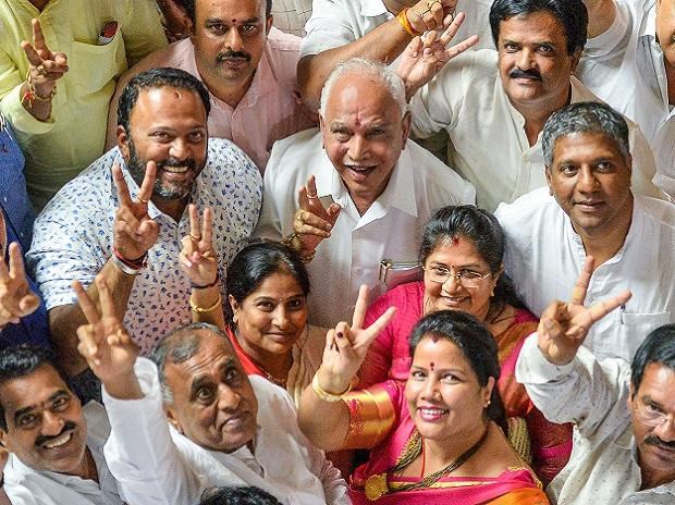 BJP State President BS Yeddyurappa with his party MLAs show victory sign after HD Kumaraswamy lost the vote of confidence during Assembly Session at Vidhana Soudha. Photo: PTI