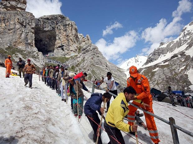 Hindu pilgrims leave the holy cave of Lord Shiva after worshipping in Amarnath, southeast of Srinagar