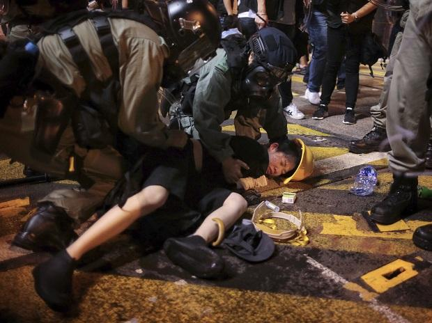 Hong Kong: Hong Kong police officers detain a protester on the streets of Hong Kong. (AFP/PTI)
