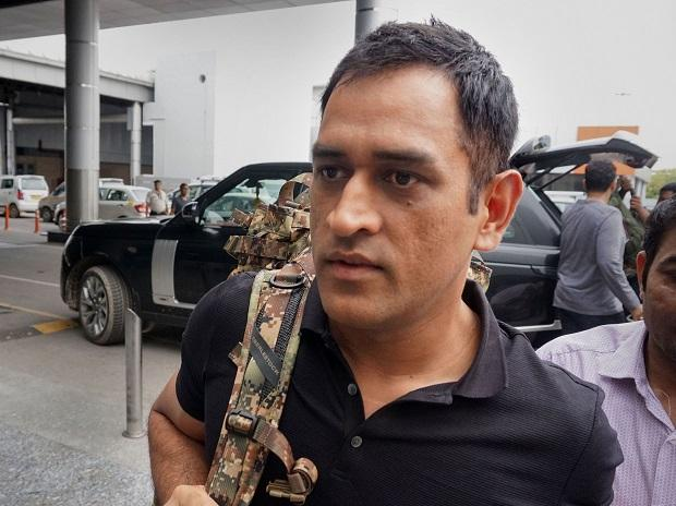 New Delhi: Cricketer MS Dhoni spotted at Delhi airport on his way to Srinagar for army duty, in New Delhi, Tuesday, July 30, 2019. (PTI Photo)