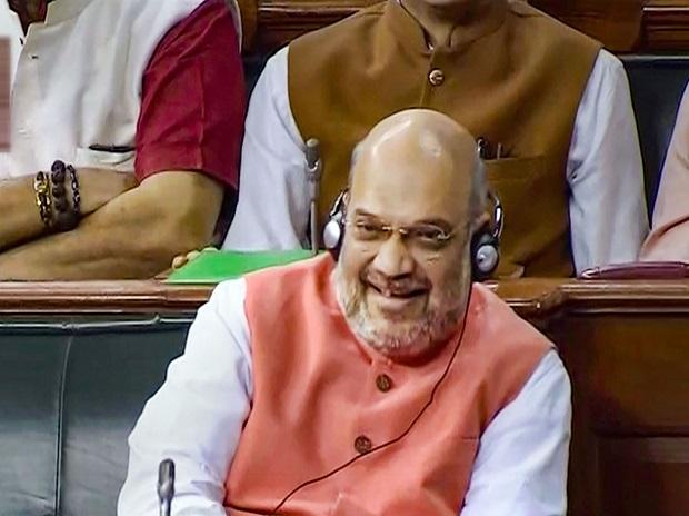 Union Home Minister Amit Shah listens to other parliamentarians during the resolution on Kashmir in the Lok Sabha, in New Delhi
