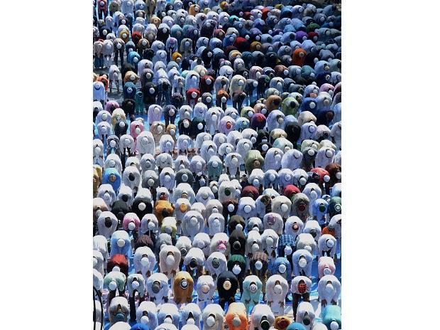The faithful offer prayers at Machkhowa Eidgah, in Guwahati