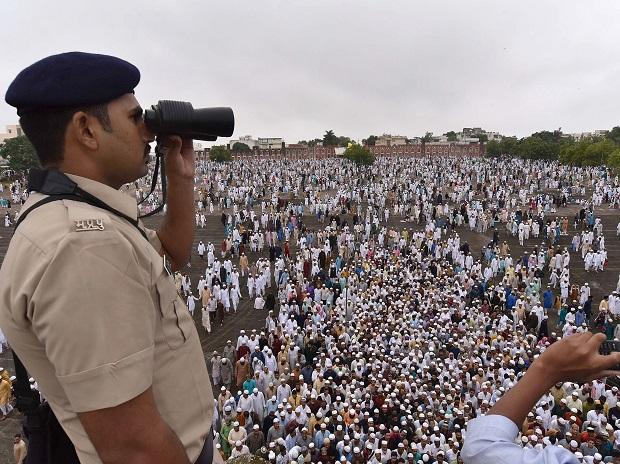 A policeman keeps vigil as people gather at an Eidgah in Bhopal to offer prayers
