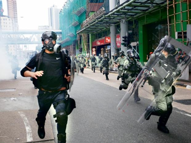 Riot police chase protesters
