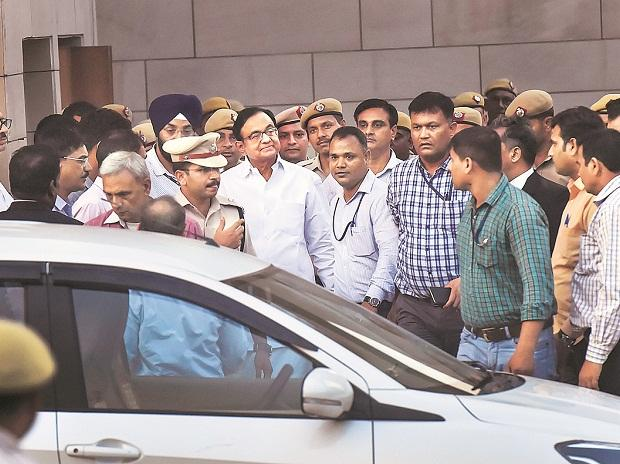 Former finance minister P Chidambaram being taken to court by CBI officials, in New Delhi on Thursday |	photo: pti